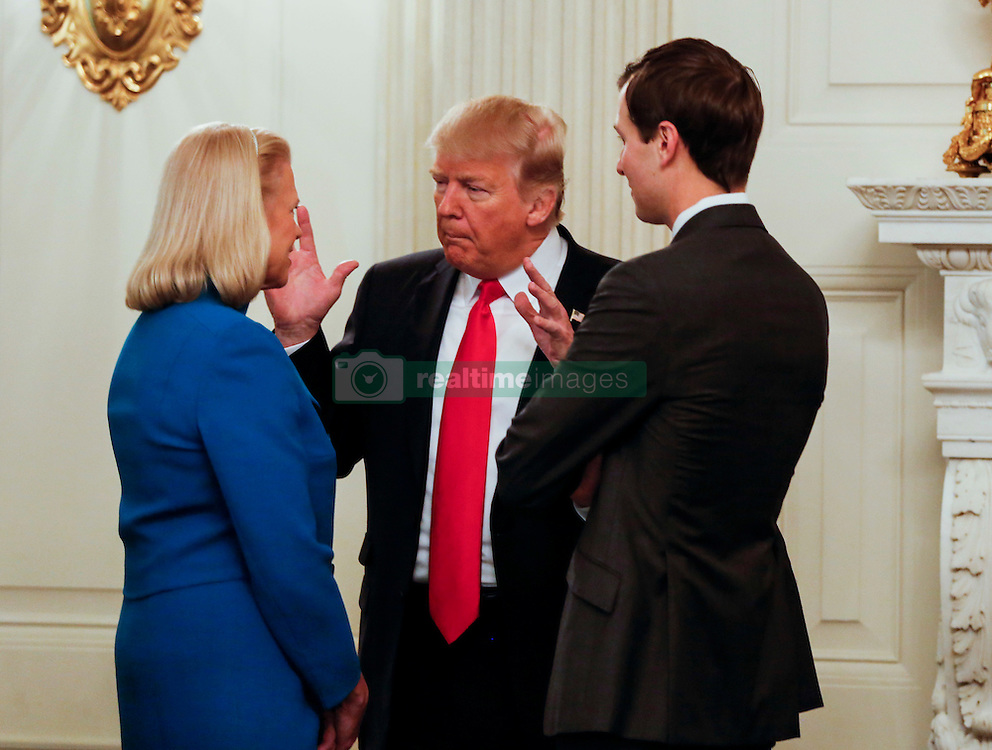 Washington, DC - February 3, 2017; U.S. President Donald speaks with Ginni Rometty, CEO of IBM (L), and Senior Adviser Jared Kushner (R) before a strategy and policy forum in the State Dining Room of the White House.