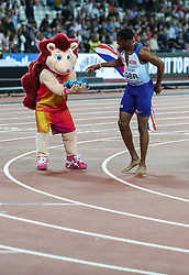 London, August 12 2017 . Hero the Hedgehog receives Nethanneel Mitchel-Blake's shoes after the men's 4x 100m relay on day nine of the IAAF London 2017 world Championships at the London Stadium. © Paul Davey.
