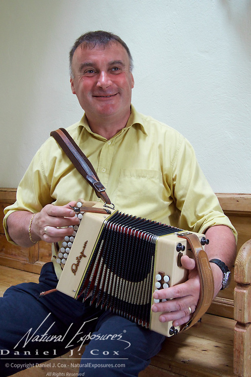 Steve McSweeney entertains our group at Connemara Hill Village, plain his traditional Irish accordion. Ireland.