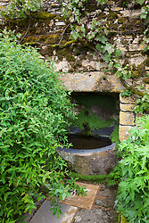 Stone water feature at Snowshill Manor