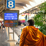 Buddhist monk catching train at Hua Lamphong station