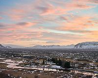 Þingvellir national park at sunrise in winter. Pink and orange clouds on sky. South Iceland.