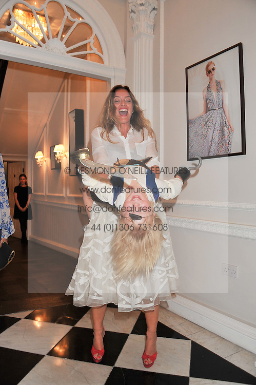 ALICE TEMPERLEY and her son FOX VON BENNIGSEN at the Frocks and Rocks party hosted by Alice Temperley and Jade Jagger at Temperley, Bruton Street, London on 25th April 2013.