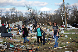 24 February 2016. Sugar Hill RV Park, Convent, Louisiana.<br /> Scenes of devastation following a deadly EF2 tornado touchdown. 2 confirmed dead. <br /> Erin Bumgardner (center) helps recover her best friend's belongings from the flipped trailers and cars dotting the landscape.<br /> Photo©; Charlie Varley/varleypix.com