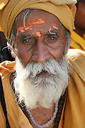 A pilgrim during the Kumbh Mela festival, Ujjain, Madhya Pradesh, India. The Kumbh Mela festival is a sacred Hindu pilgrimage held 4 times every 12 years, cycling between the cities of Allahabad, Nasik, Ujjain and Hardiwar. Past Melas have attracted up to 70 million visitors.
