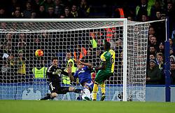 Sebastien Bassong of Norwich City sees his shot blocked by John Terry of Chelsea - Mandatory byline: Robbie Stephenson/JMP - 07966 386802 - 21/11/2015 - FOOTBALL - Stamford Bridge - London, England - Chelsea v Norwich City - Barclays Premier League