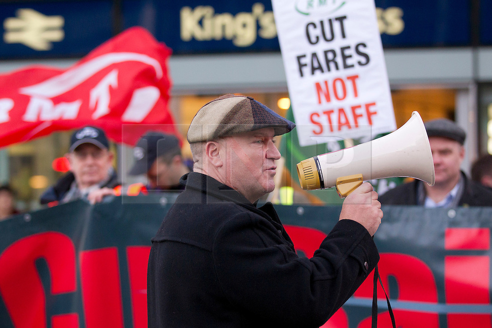 © Licensed to London News Pictures. 02/01/2014. London, UK. RMT Union General Secretary Bob Crow is seen talking to protesters at a demonstration over today's (02/01/2014) 3.1% rail fare rise outside King's Cross Station in London this morning. The rail fare rise came in to force today as most across the country returned to work for the start of 2014. Photo credit: Matt Cetti-Roberts/LNP