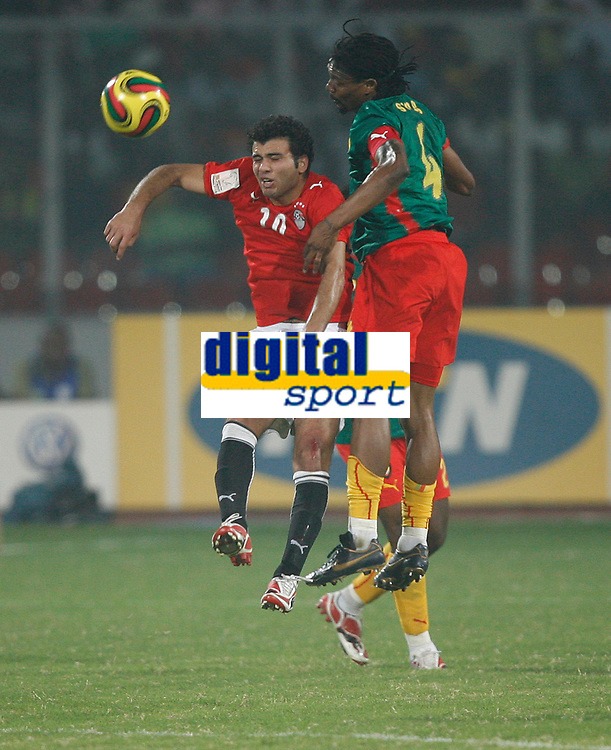 Photo: Steve Bond/Richard Lane Photography.<br />Egypt v Cameroun. Africa Cup of Nations. 22/01/2008. Emad Meteeb (L) and Rigobert Song (R) in an aeriel challange