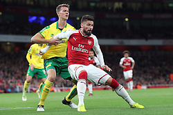 24 October 2017 - Football League Cup Round of 16 - Arsenal v Norwich City - Olivier Giroud of Arsenal pulls own the shirt of Christoph Zimmermann of Norwich as they wait for a cross - Photo: Charlotte Wilson / Offside