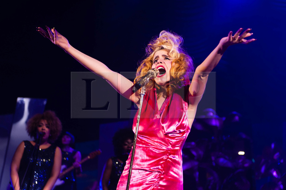 """© Licensed to London News Pictures. 07/02/2013. London, UK.   Paloma Faith performing live at Hammersmith Apollo. Paloma Faith is an English singer-songwriter and actress.  Since 2007 Faith has acted in three films and she released her second album, """"Fall to Grace"""" in 2012.  The first single from that album, """"Picking up the Pieces"""", became Faith's highest charting single to date to go platinum in the UK.  Photo credit : Richard Isaac/LNP"""