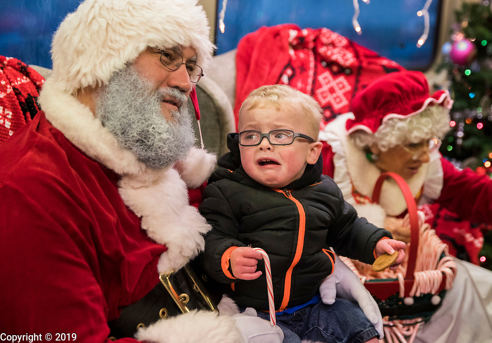 Casen Combs, who had already met Santa last year shows apprehension this year on Indiana Railroad Company Santa Train, December 1, 2018 in Solsberry, Ind.