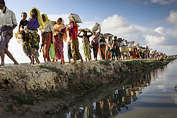 October 9, 2017 - Cox's Bazar, Bangladesh - Hundreds of Rohingya people crossing Bangladesh's border as they flee from Buchidong at Myanmar after crossing the Naf River in Bangladesh. According to the United Nations High Commissioner for Refugees (UNHCR) more than 525,000 Rohingya refugees have fled from Myanmar for violence over the last month with most of them trying to cross border reach Bangladesh. International organizations have reported claims of human rights violations and summary executions allegedly carried out by the Myanmar army. (Credit Image: © KM Asad via ZUMA Wire)