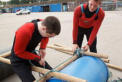Visually impaired men doing raft-building activity at the National Water Sports Centre.