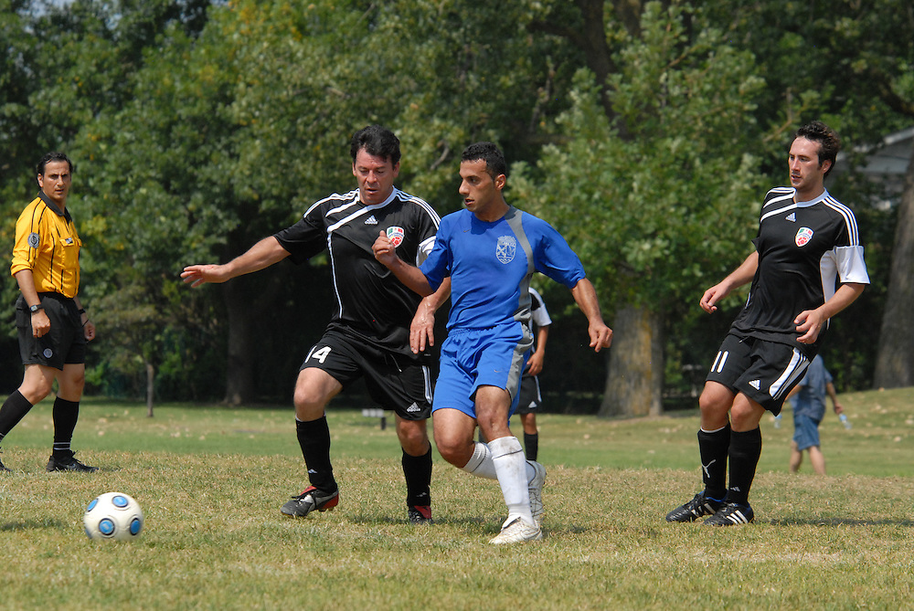 Sebasifian Gomez (#14) of Deportivo Colomex competes for control of the ball while competing with Team Shlama F.C. during National Soccer League play in Skokie, Il.  .