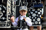 A pearly prince at St Martin-in-the-Fields church for their annual Harvest Festival on 6th October 2019 in London, United Kingdom. The tradition of the Pearly Kings and Queens originated in the 19th century when London street sweeper Henry Croft decorated his uniform and began collecting money for charity. The annual harvest festival sees Pearly Kings and Queens gather to celebrate the autumn harvest with a church service.