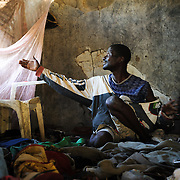 Schizophrenia patient, Moses (32), in his room above his brother's home where he lives in Koidu town in the Kono District of eastern Sierra Leone.