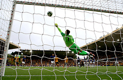 Everton goalkeeper Jordan Pickford fails to stop the ball as Wolverhampton Wanderers' Ruben Neves scores his side's first goal of the game during the Premier League match at Molineux, Wolverhampton.