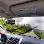 Riding down a two-lane road in a rural area near Bonner Springs, Kansas.