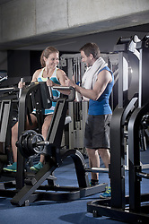 Couple talking to each other in the gym, Bavaria,  Germany