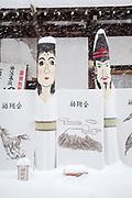 Shop display with buddhism figurines in snow, Nozawaonsen, Japan