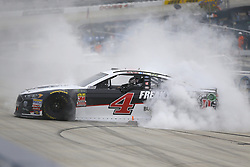 May 6, 2018 - Dover, Delaware, United States of America - Kevin Harvick (4) celebrates after winning the AAA 400 Drive for Autism at Dover International Speedway in Dover, Delaware. (Credit Image: © Chris Owens Asp Inc/ASP via ZUMA Wire)