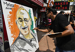 October 2, 2018 - Assam, India - An artist painting Mahatma Gandhi's portrait in the street in the occasion of Gandhi Jayanti organized by My Gov Assam in Guwahati, Assam, India on Tuesday, 2 October 2018. (Credit Image: © David Talukdar/NurPhoto/ZUMA Press)
