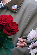 """Moscow, Russia, 24/04/2007..The body of former Russian President Boris Yeltsin lies in state in the Cathedral of Christ the Saviour as mourners visit to pay their last respects. Two mourners carrying flowres and wearing badges reading """"Yeltsin - Our President""""."""
