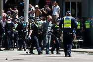 A man is arrested during the Melbourne Freedom Rally at Parliament House. Police move into position on the steps of state parliament ahead of a planed protest. The groups who have organised the many Freedom Day protests over the last 3 months, attempted to march on State Parliament during Melbourne Cup Day demanding the sacking of Premier Daniel Andrews for the lockdown and attacks on their civil liberties. Police met with the protester's with significant force despite the city having had zero cases for five days. (Photo by Dave Hewison/Speed Media)