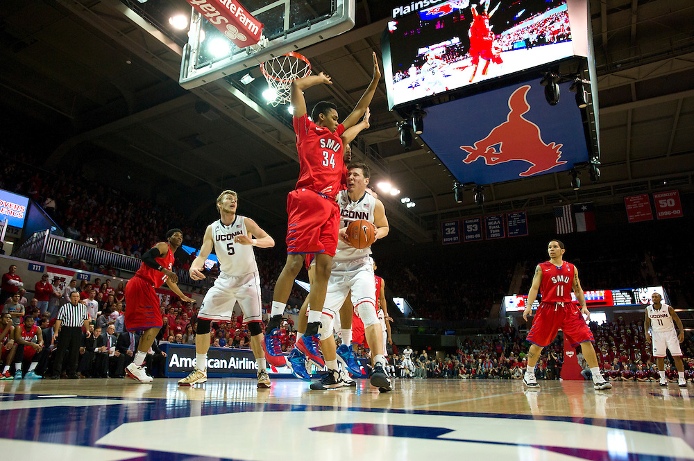 DALLAS, TX - JANUARY 4: Tyler Olander #10 of the Connecticut Huskies drives to the basket against the SMU Mustangs on January 4, 2014 at Moody Coliseum in Dallas, Texas.  (Photo by Cooper Neill/Getty Images) *** Local Caption *** Tyler Olander