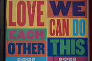 Local response to Coronavirus is felt on a street by street level as posters are pasted up on a hoarding promoting community love and belief, reading: Love each other and We can do this on 13th April 2020 in Birmingham, England, United Kingdom. Coronavirus or Covid-19 is a new respiratory illness that has not previously been seen in humans. While much or Europe has been placed into lockdown, the UK government has announced more stringent rules as part of their long term strategy, and in particular social distancing.