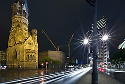 Traffic light trail on road and church at roadside, Kaiser Wilhelm Memorial Church,  Berlin, Kurfurstendamm, Germany