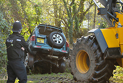 © Licensed to London News Pictures. 23/11/2012. Chew Stoke, UK.  A man died last night when his vehicle got swept off a ford down a river and got stuck under a bridge in Chew Stoke in Somerset.  The vehicle was recovered this afternoon with a JCB.  23 November 2012..Photo credit : Simon Chapman/LNP