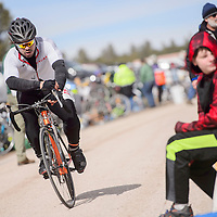 Armando Mondragon pedals out of the final bicycle transition during the Mount Taylor Winter Quadrathlon in Grants Saturday.