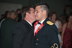 father and son at party reception kissing