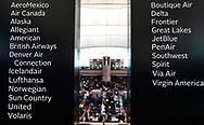 The security entrance is seen behind signs listing airlines serving Denver International Airport outside Denver, Colorado U.S. November 3, 2017.  REUTERS/Rick Wilking