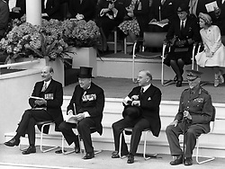 File photo dated 08/06/46 showing Clement Attlee and next to him, the Prime Minister Winston Churchill, watching the march past celebrating VE (Victory in Europe) Day in London, marking the end of the Second World War in Europe.