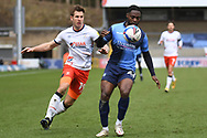Luton Town forward James Collins (19)battles for possession  with Wycombe Wanderers midfielder Fred Onyedinma (23) during the EFL Sky Bet Championship match between Wycombe Wanderers and Luton Town at Adams Park, High Wycombe, England on 10 April 2021.