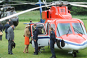 State Visit of the presidentof Chili , Michelle Bachelet to the Netherlands.<br /> <br /> On the photo Presedent of Chili, Michelle Bachelet, Queen Beatrix and Princes Maxima leave from the Castle of Doorwerth with a helicopter