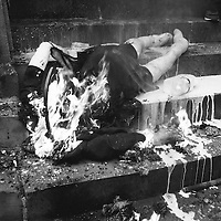 Liverpool, UK, 17th April, 2013. An effigy of Margaret Thatcher is burned on the steps of St Georges Hall in Liverpool. Milk is poured over the burning effigy.