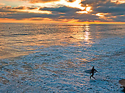 Sunset Surfer Getting in the Water in Orange County