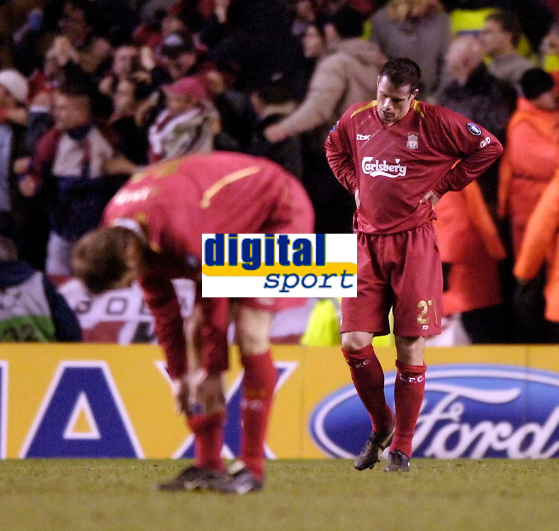 Photo: Jed Wee.<br /> Liverpool v Benfica. UEFA Champions League. 08/03/2006.<br /> <br /> Liverpool's Jamie Carragher (R) and Dietmar Hamann feel the pain of defeat.