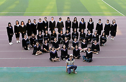 June 11, 2017 - Taiyuan, Taiyuan, China - Taiyuan, CHINA-June 11 2017: (EDITORIAL USE ONLY. CHINA OUT) ..A boy and 39 girls pose for a graduation photo at Taiyuan Normal University in Taiyuan, north China's Shanxi Province, June 11th, 2017. There is only one male student in the class majoring in pre-school education. (Credit Image: © SIPA Asia via ZUMA Wire)