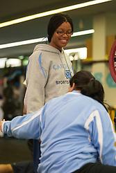 16 November 2007: North Carolina Tar Heels men's lacrosse athletic trainer Nina Walker with strength and conditioning coach Melissa Glyptis in a weight lifting session in Chapel Hill, NC.
