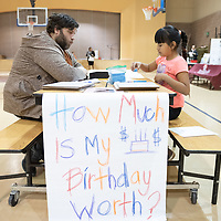 On Thursday in Twin Lakes, 4th grader Morningstar Barney, 7, right, works with Special Education teacher Eric Godfrey   during the Family Math Night held at Twin Lakes Elementary School.