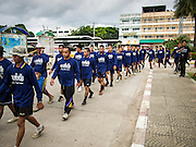 30 JULY 2013 - KOH SAMET, RAYONG, THAILAND:  Thai Royal Navy volunteers in formation before going to Koh Samet to clean up an oil spill. About 50,000 liters of crude oil poured out of a pipeline in the Gulf of Thailand over the weekend authorities said. The oil made landfall on the white sand beaches of Ao Prao, on Koh Samet, a popular tourists destination in Rayong province about 2.5 hours southeast of Bangkok. Workers from PTT Global, owner of the pipeline, and up to 500 Thai military personnel are cleaning up the beaches. Tourists staying near the spill, which fouled Ao Prao beach, were evacuated to hotels on the east side of the island, which was not impacted by the spill. PTT Global Chemical Pcl is part of state-controlled PTT Pcl, Thailand's biggest energy firm.     PHOTO BY JACK KURTZ