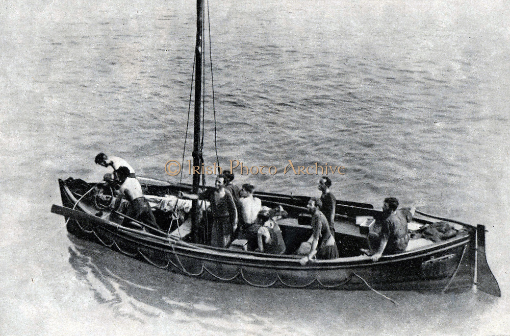 British merchant seamen about to be taken aboard a British warship. After their ship had been sunk, they were adrift in a lifeboat for ten days with just a  few biscuits and a little water.