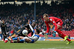 Wigan's Richard Christian Walton collects the ball after Blackburn's Bradley Dack is tackled by Cheyenne Dunkley