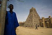 A man stands near Sankoré Mosque, in Timbuktu, Mali.