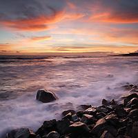 Hale o Lono Harbor breakwater wall sunset