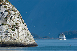 """Alaskan Dream Cruises """"Alaskan Dream"""" sails past South Marble Island in Glacier Bay National Park and Preserve in the main bay of the park in southeast Alaska. Alaska Dream Cruises is an Alaska native-owned company."""